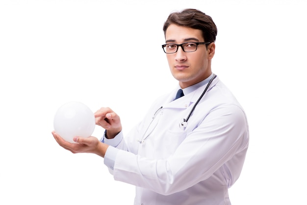 Doctor with crystal ball isolated on white