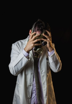 Doctor with gas mask and severe headache