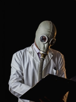 Doctor with gas mask writing a prescription