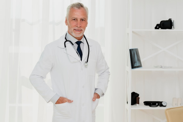 Doctor with hands in pocket looking at camera