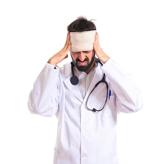 Doctor with headache over white background