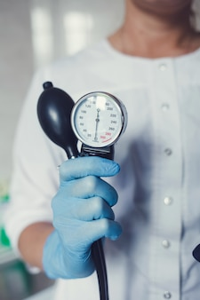 Doctor with medical blood pressure
