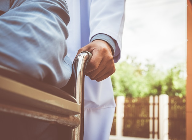 Doctor with patient, disabled concept.