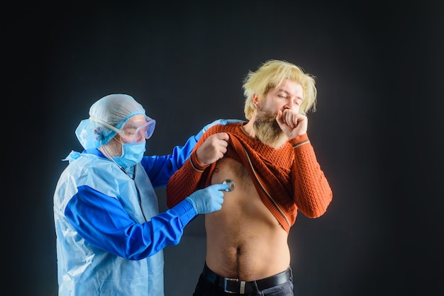 Doctor with stethoscope listens lungs of patient. medic examining man with stethoscope.