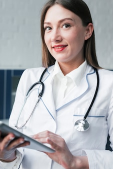 Doctor with a stethoscope and a tablet