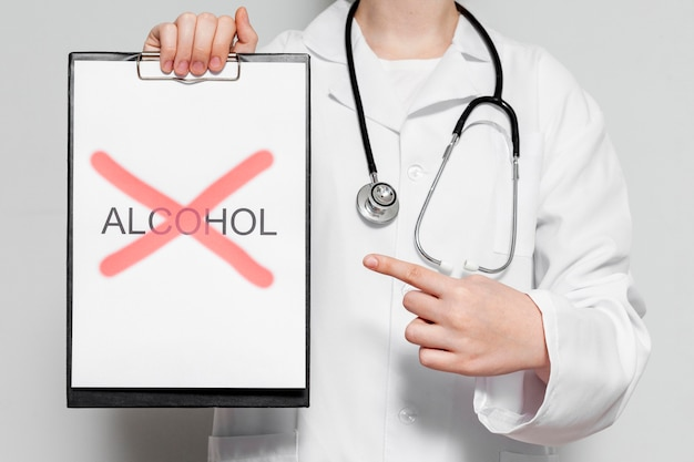 Doctor with stop consuming alcohol message