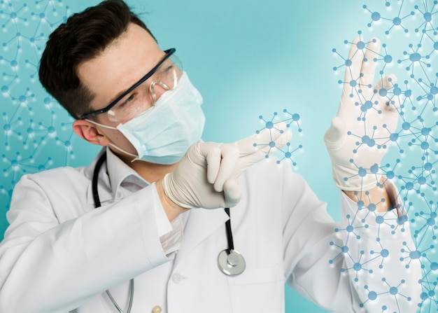Doctor with surgical gloves and medical mask analyzing molecular structures