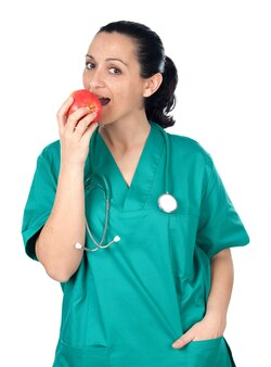 Doctor woman eating red apple isolated on white background