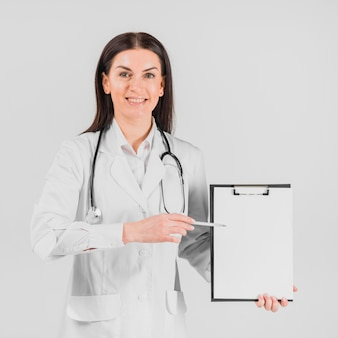 Doctor woman showing on clipboard