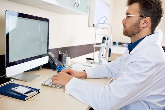 Doctor working with computer in office