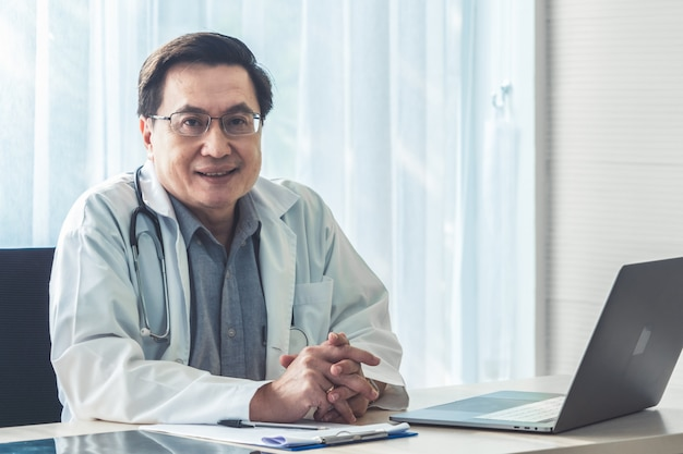 Doctor working with patient health data in the hospital office.