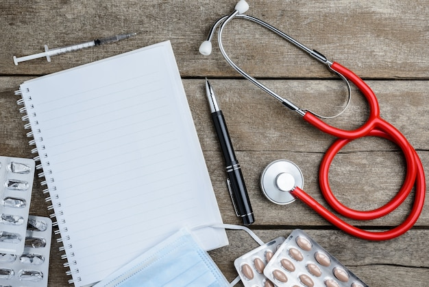 Doctor workplace with a stethoscope on wooden table