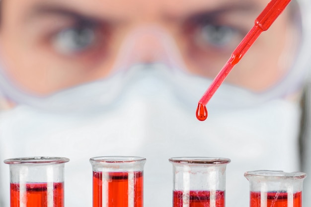 Doctor works with blood sample. blood test in laboratory. medical equipment. blood research. closeup.