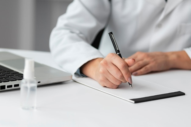 Doctor writing medical prescription