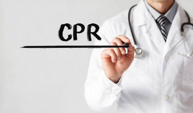 Doctor writing word cpr with marker