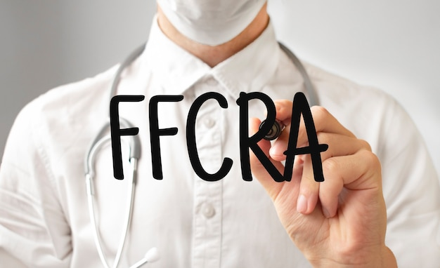 Doctor writing word ffcra with marker, medical concept