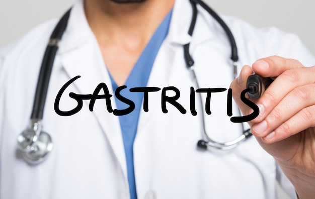 Doctor writing the word gastritis