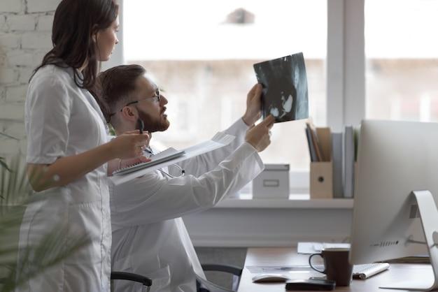 Doctors discussing intestines