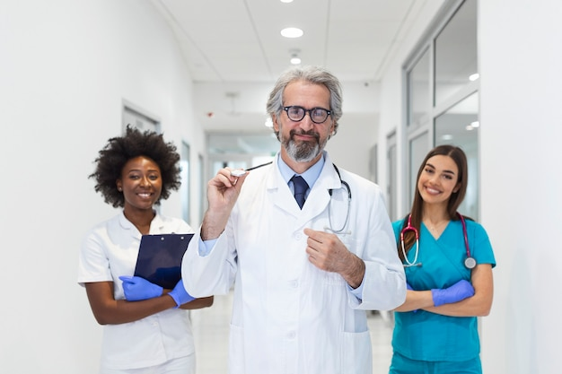 Doctors dressed in medical scrubs and white lab coats with stethoscopes around their necks.