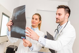 Doctors examining an x-ray of the patient at clinic