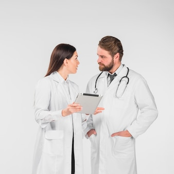 Doctors female and male discussing and looking at each other