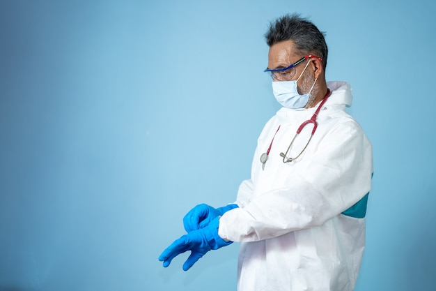 Doctors in hazmat ppe protective clothing wear medical rubber gloves for protection coronavirus disease 2019 (covid-19)