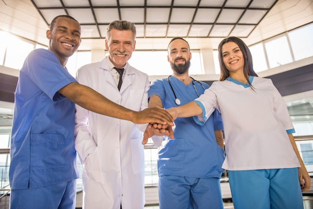 Doctors at the hospital clasped hands together as a team.