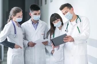 Doctors in masks using tablet