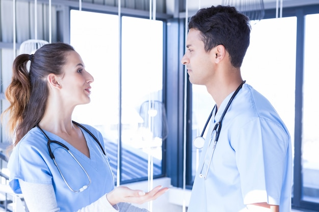 Doctors interacting with each other in hospital