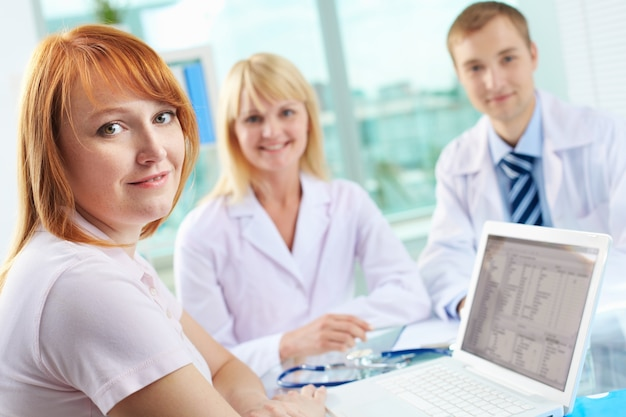 Doctors looking through the medical record