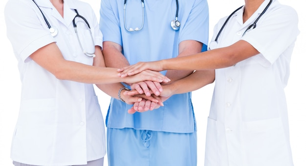 Doctors and nurse putting their hands together