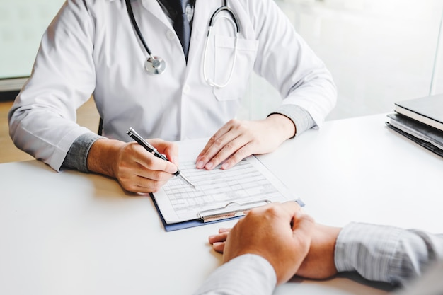 Doctors and patients consulting and diagnostic examining sit and talk