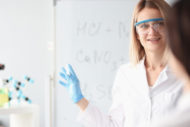 Doctors scientists are standing next to white board. chemical analysis laboratory technicians concept