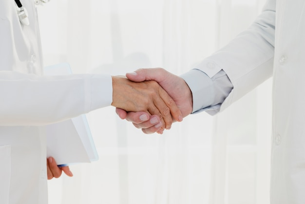 Doctors shaking hands close-up