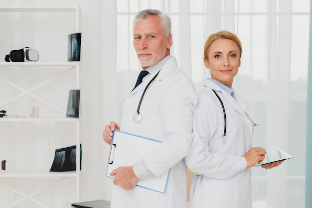 Doctors standing back to back