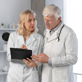 Doctors talking and checking notes