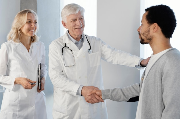 Doctors talking with a young patient