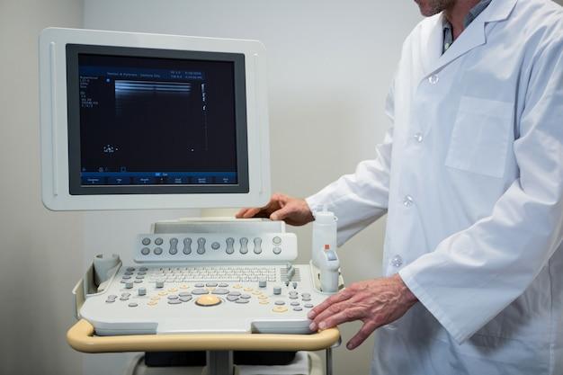 Doctors using sonography machine