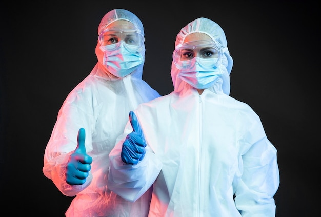 Doctors wearing protective medical equipment