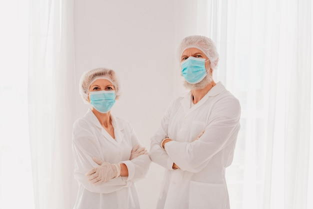 Doctors with mask and face protector are ready to work in hospital