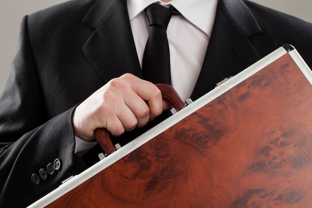 Document case in businessman hands