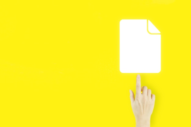 Document management data system. young woman's hand finger pointing with hologram document icon on yellow background. online documentation database.