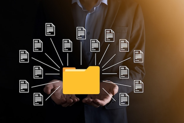 Document management system dms .businessman hold folder and document icon.software for archiving, searching and managing corporate files and information.internet technology concept.digital security.