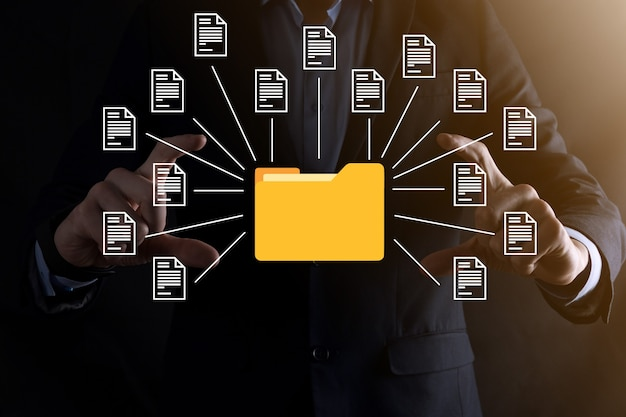 Document management system (dms).businessman hold folder and document icon.software for archiving, searching and managing corporate files and information.internet technology concept.digital security.