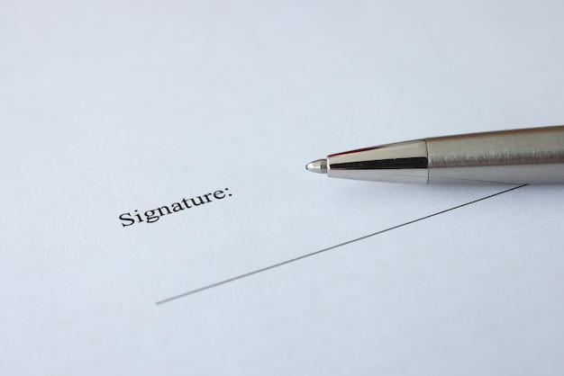Document and pen for signing are on table signing contracts and agreements concept