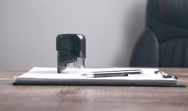 Document, pen and stamp on the table.