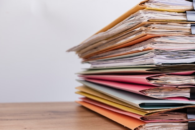Document stacked on the office desk.