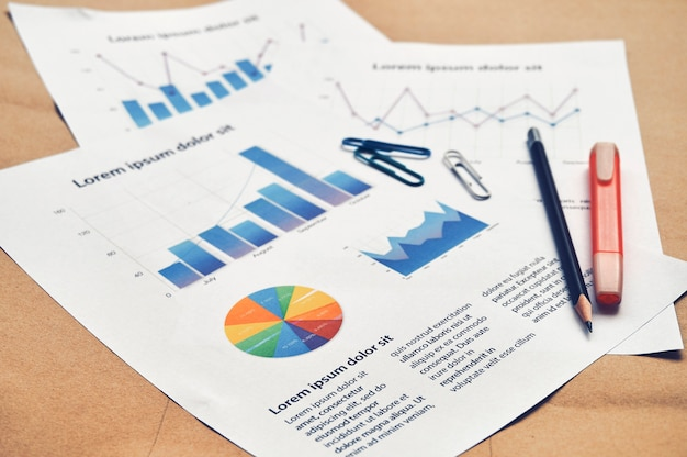Documents dummy financial statistics with pie graph, bar and line chart. business analysis concept