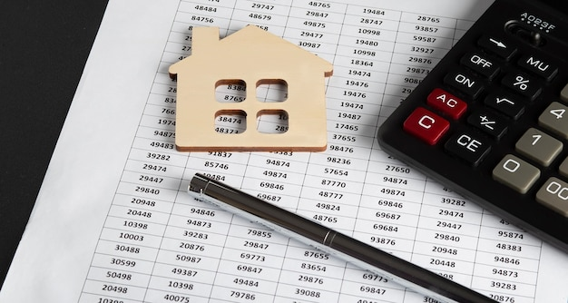 Documents file paperwork financial or property mortgage real estate investment business with calculator...