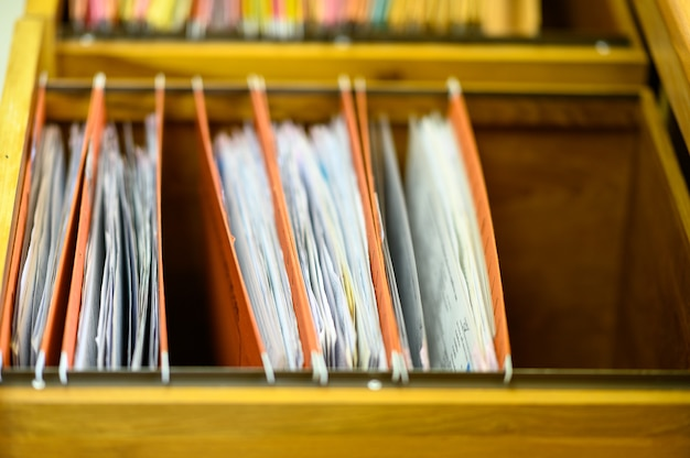 Documents in files placed in filing cabinet